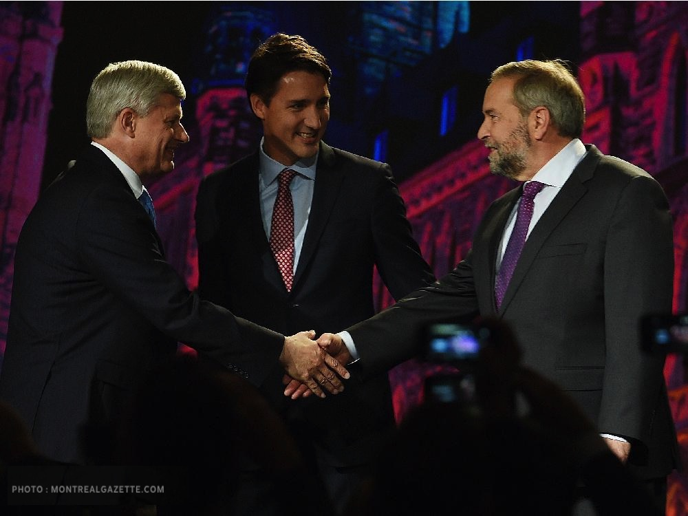 NDP leader Tom Mulcair shakes hands with Conservative leader Stephen Harper as Liberal leader Justin Trudeau looks on during their introduction prior to the Globe and Mail hosted leaders' debate in Calgary on Thursday, September 17, 2015. THE CANADIAN PRESS/Sean Kilpatrick
